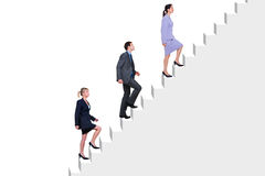 Business people climbing stairs. Three business people climbing a flight of stairs, white background Royalty Free Stock Images