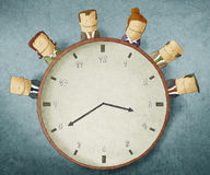 Business people with clock Royalty Free Stock Photos