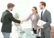 Business people closing a deal and handshaking at the office Stock Image