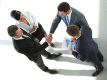 Business people closing a deal and handshaking at the office Royalty Free Stock Photo