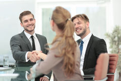 Business people closing a deal and handshaking at the office Royalty Free Stock Photos
