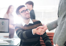 Business people closing a deal and handshaking at the office Stock Images