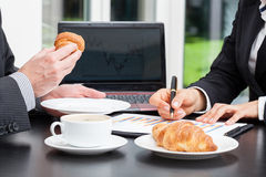 Business people with coffee Royalty Free Stock Photography