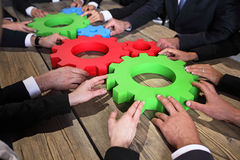 Business people with cogs of business. Business people with colorful cogs of business, problem sloution concept Royalty Free Stock Photo
