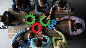 Business people with cogs of business. Business people with colorful cogs of business, problem solution concept
