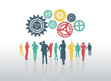 Business people with cogs and wheels Royalty Free Stock Photos