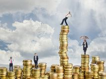 Business people on coin. Different business people on golden euro coin stock image