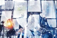 Business people collaborate together in office. Double exposure effects. Business people collaborate together in a modern office. Double exposure effects royalty free stock photo