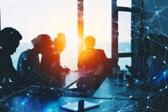 Silhouette of business people work together in office. Concept of teamwork and partnership. double exposure with network royalty free stock photography