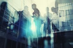 Silhouette of business people working together in office. Concept of teamwork and partnership. double exposure with. Business people collaborate together in royalty free stock images