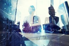 Business people work together in office. Concept of teamwork and partnership. double exposure with network effects royalty free stock image