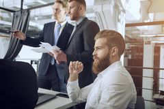 Business people collaborate together in office. Business people collaborate together in a modern office during a meeting royalty free stock photo