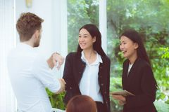 Business people colleagues handshake with success during meeting. stock image