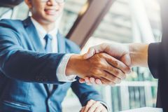 Business people colleagues shaking hands during a meeting to sign agreement for New Partner Planning Strategy Analysis Concept stock images