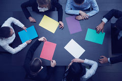 Business people and color paper Royalty Free Stock Photos