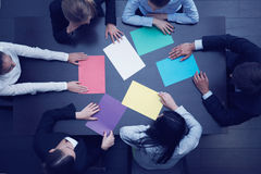 Business people and color paper Stock Photography