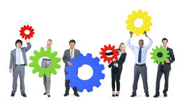 Business People with Colourful Gear Symbol Stock Images