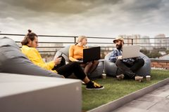 Business people communication, office teamwork. 30 years old people on roof coworking area
