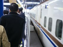 Business people commuters queue on Train platform Japan transportation stock photo