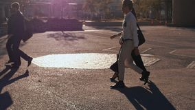 Business people commuting to office. Office going people commuting on a city street early in the morning carrying bags. Business people walking on a busy city stock video footage