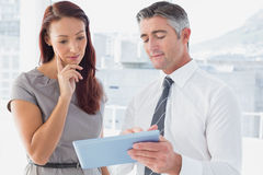 Business people comparing work notes Royalty Free Stock Photos