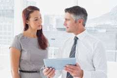 Business people comparing work notes Royalty Free Stock Photo