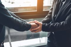 Business people compassionately holding hands at office room. stock images