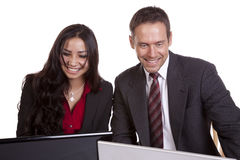 Business people on computers smiling Stock Images