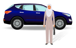 Business people concept. Arab businesswoman standing on a luxury car background. Royalty Free Stock Image