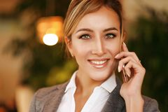 Business and people concept: Businesswoman with mobile phone Royalty Free Stock Photography