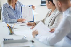 Business team discussing report at office royalty free stock images