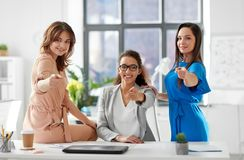 Group of businesswomen pointing to you at office. Business and people concept - group of businesswomen pointing to you at office Royalty Free Stock Photo