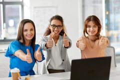 Group of businesswomen showing thumbs up at office. Business and people concept - group of businesswomen showing thumbs up at office Royalty Free Stock Image