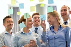 Business team at glass wall with sticky notes Stock Images