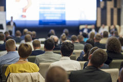 Business People Concept and Ideas. Large Group of People at the Conference Watching Presentation Charts on Screen royalty free stock photos