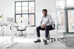 African businessman sitting on office chair Royalty Free Stock Images
