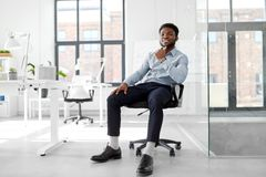 African businessman sitting on office chair Stock Photos