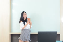 Business and people concept - smiling businesswoman presentation Stock Photography