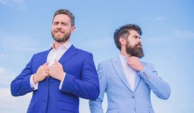Business people concept. Well groomed appearance improves business reputation entrepreneur. Business men stand blue sky stock photo