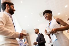 Business people with conference badges and coffee Stock Photography