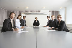 Business People At Conference Table Royalty Free Stock Photography