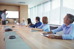 Business people at conference table during meeting. In board room Stock Images