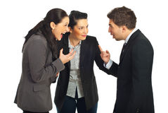 Business people conflict. Two nervous business people arguing and screaming each other and other business woman trying to settling the conflict Royalty Free Stock Photos