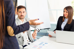 Business people conflict problem working in team together. Young business people conflict problem working in team together Stock Photo