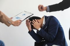 Business people conflict problem working in team turns into fight.  stock photography