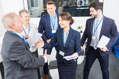 Business people congratulate business consultant. Speaker after successful seminar stock images