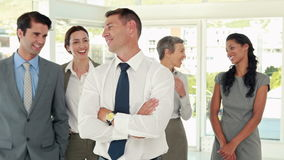 Business people congratulating their colleague stock footage