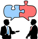 Business people connect collaborate puzzle talk. Two business people talk to find solution in puzzle shape speech bubbles Stock Photo