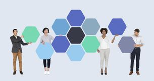 Business people with connected hexagon boards royalty free stock photography