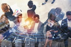 Business people connected on internet network with laptop and tablet. concept of startup company. Double exposure. Business people in office connected on stock images